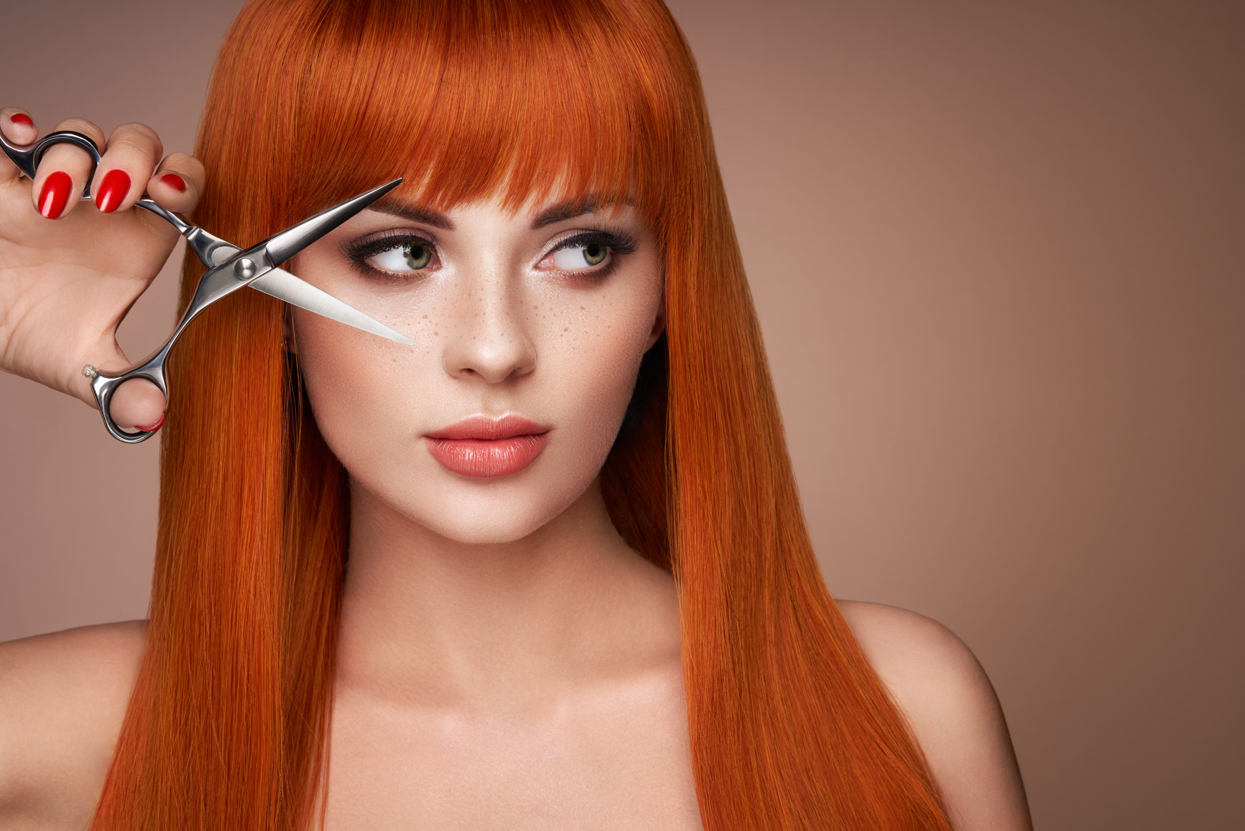 Beautiful young woman with a scissors